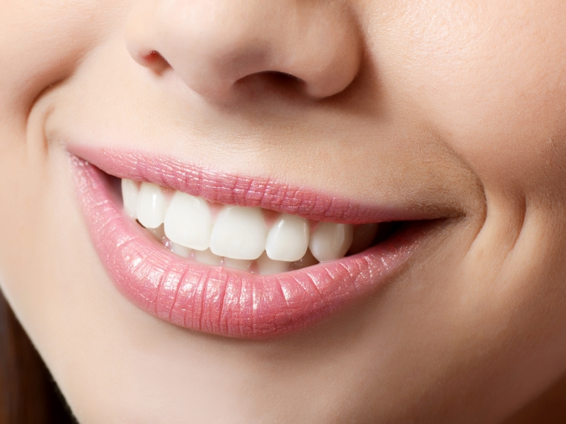 5844011-healthy-woman-teeth-and-smile